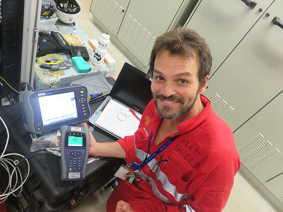 Mat Shields, Technical Director Vocus Communications with test equipment displaying positive results.