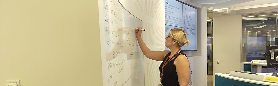 Kristy Roberts, Shell Maintenance Planner writing on the whiteboard