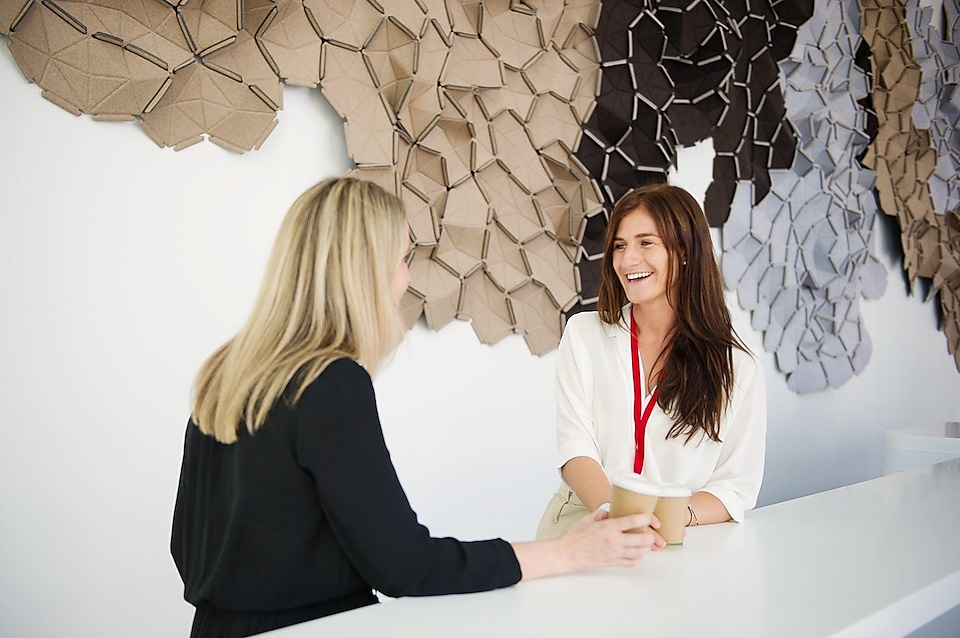 Shell Graduate Samantha Palmer having a discussion with her mentor Elise-Anne Muir over coffee