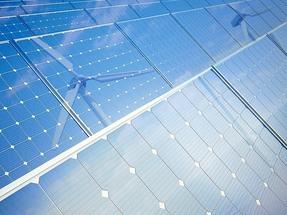 Photovoltaic panels and wind turbines, computer illustration.
