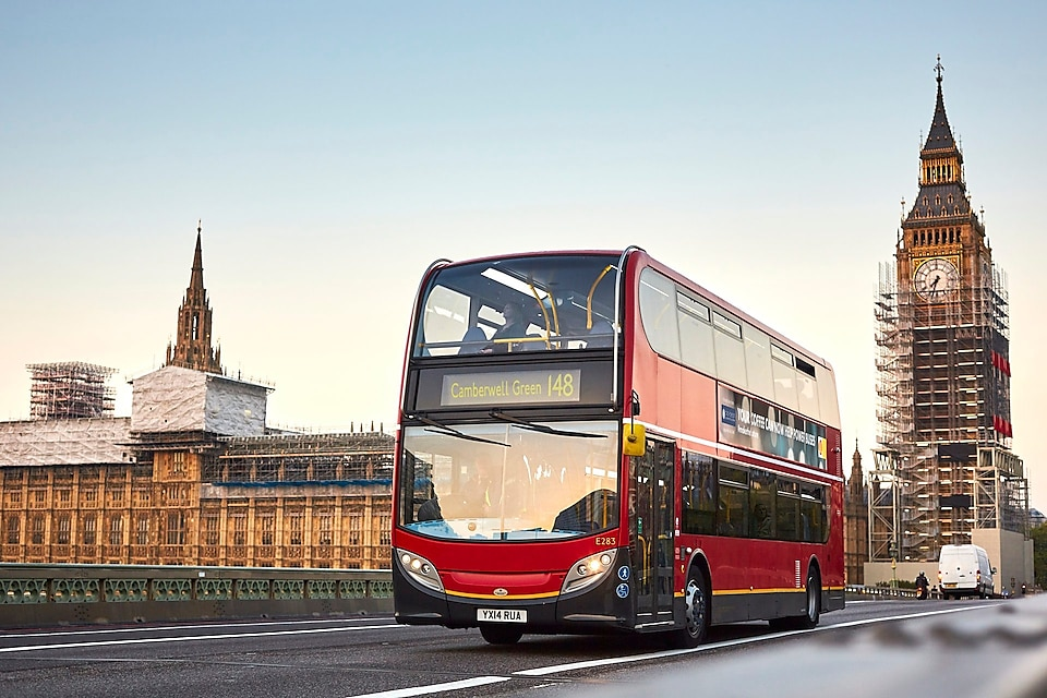 London bus driving past the Houses of Parliament