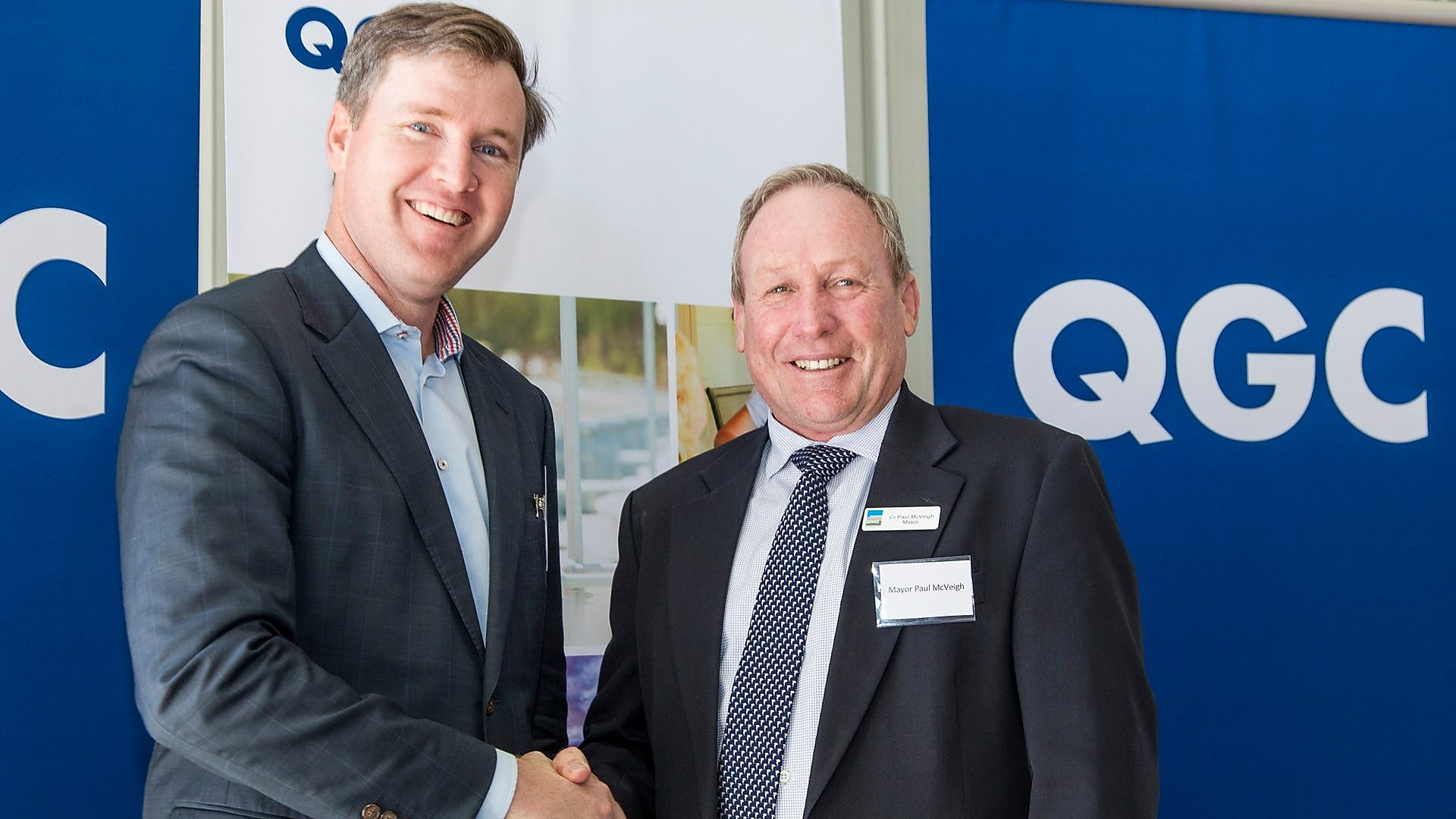 two leaders shaking hands on their QGC lathways launch